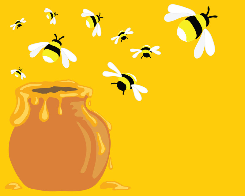 honey bees and a honey pot
